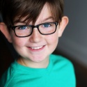 kaiden_scott_green_shirt_glasses