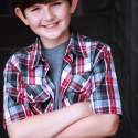 kaiden_scott_red_blue_plaid_shirt_arms_crossed